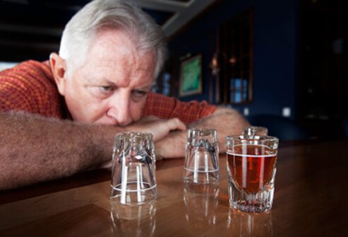 12-health-risks-of-chronic-heavy-drinking-s7-photo-of-man-with-shot-glasses